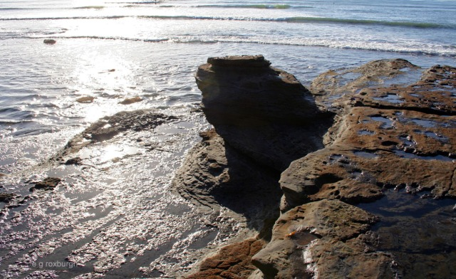 black rock w tranquil sea